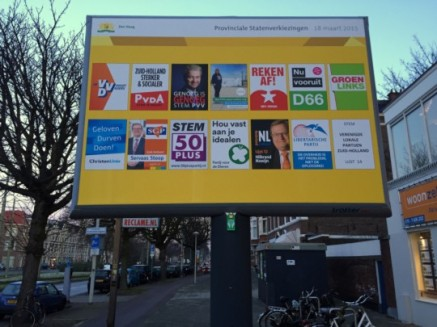An informational billboard for the provincial elections with posters for the different parties. The Freedom Party one features Geert Wilders and the slogan Enough Is Enough; the Socialist Party's slogan could be loosely translated as Settle The Score. D66 has been running with the slogan Now, Forward, while the Party for the Animals appeals to voters to Stick To Your Ideals. Photo by Patrick Rasenberg, licensed under Creative Commons.
